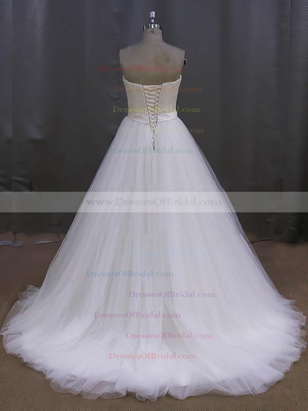 Elegant Tulle Sweetheart Pearl Detailing Sweep Train Ivory Wedding Dress #DOB00022026